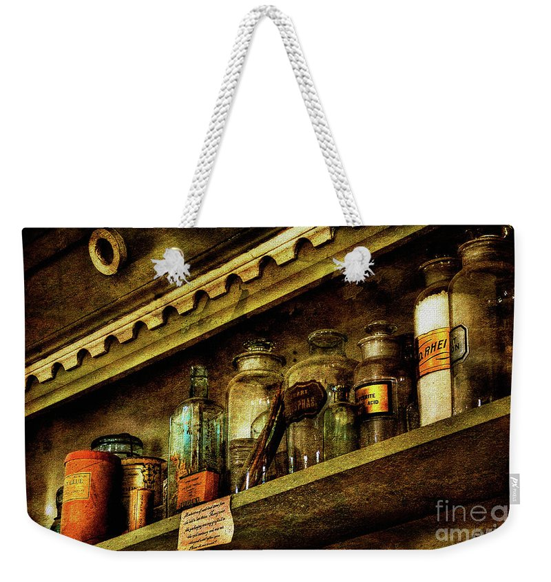 Glass Bottles Weekender Tote Bag featuring the photograph The Olde Apothecary Shop by Lois Bryan