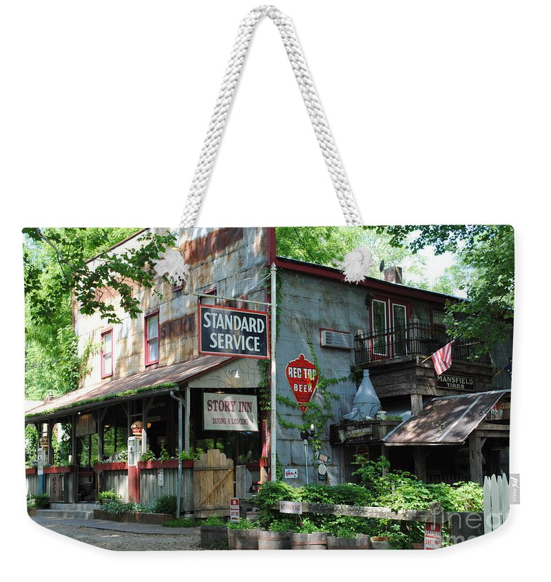 Standard Weekender Tote Bag featuring the photograph The Ole Gas Station by Jost Houk