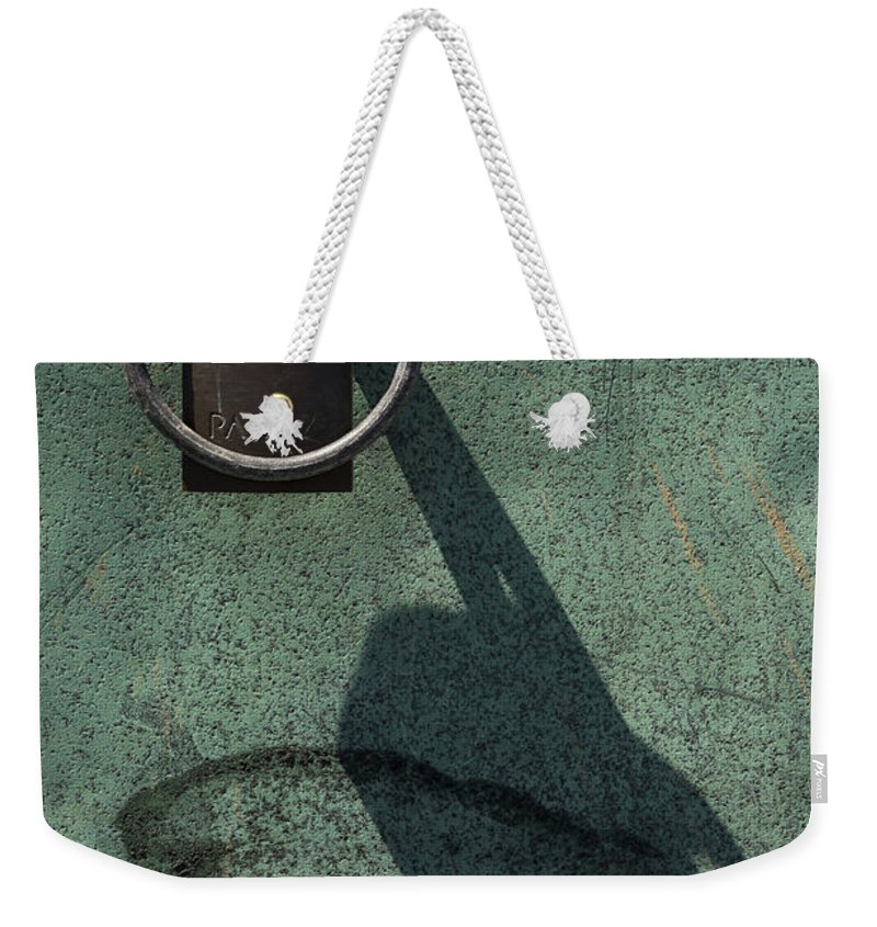 Padlock Weekender Tote Bag featuring the photograph The Padlock, Ring And Shadow by Wendy Wilton
