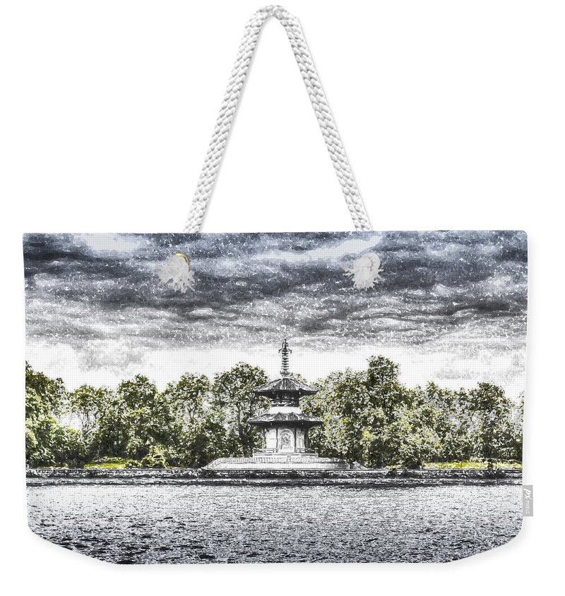 Pagoda Weekender Tote Bag featuring the photograph The Pagoda In The Snow by David Pyatt