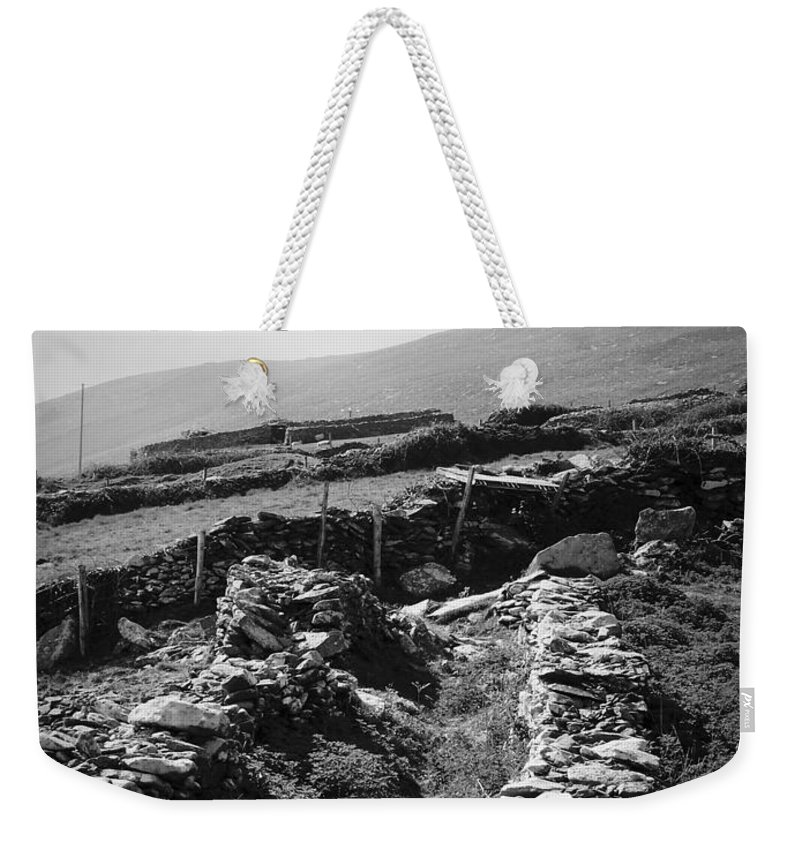 Irish Weekender Tote Bag featuring the photograph The Path To The Beehive Huts In Fahan Ireland by Teresa Mucha