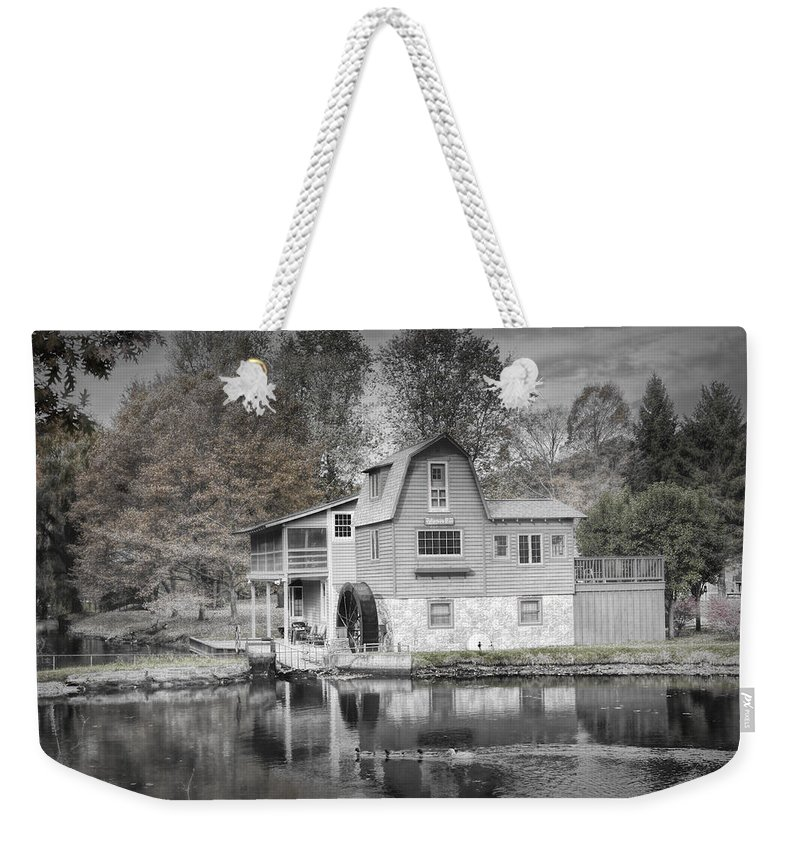 Water Weekender Tote Bag featuring the photograph The Peterson Mill In Saugatuck Michigan by Randall Nyhof