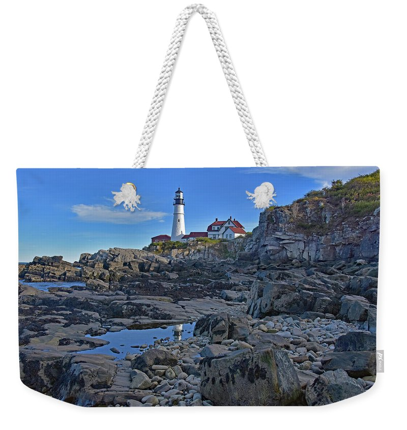 Landscapes Weekender Tote Bag featuring the photograph The Portland Lighthouse by Mary Lisa photography