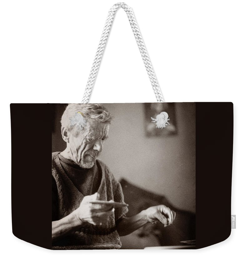 Ukraine Weekender Tote Bag featuring the photograph The Potter Of Haweryvschyna by Yuri Lev
