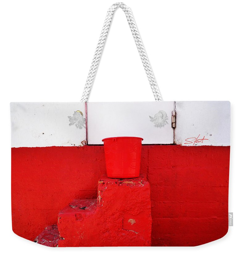Red Weekender Tote Bag featuring the photograph The Red Bucket by Charles Stuart