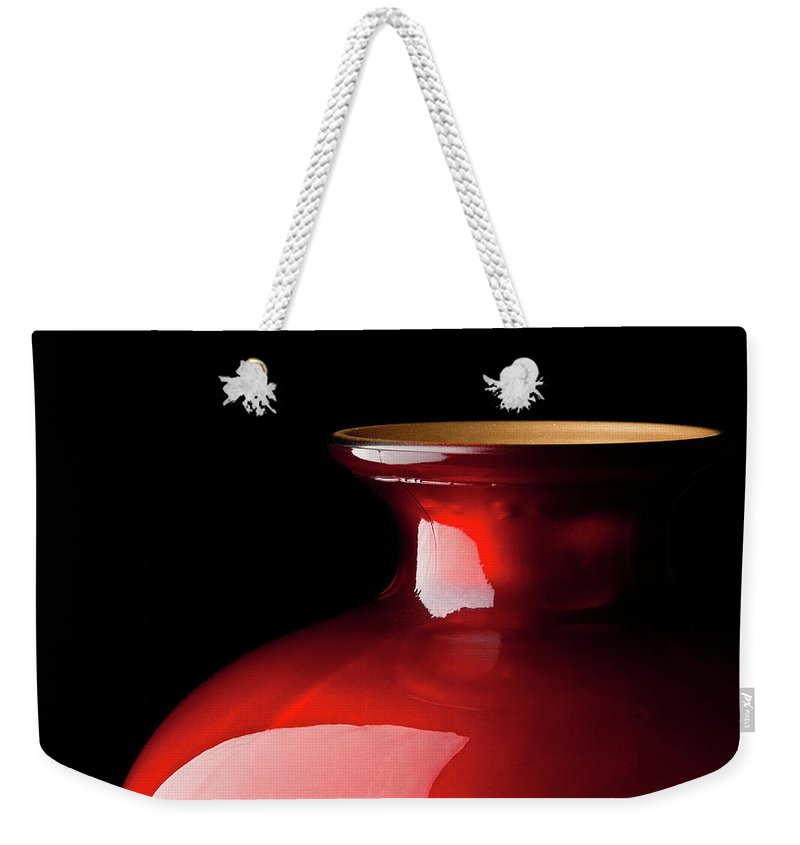 Red Glass Vase Weekender Tote Bag featuring the photograph The Red Glass Vase by Onyonet Photo Studios