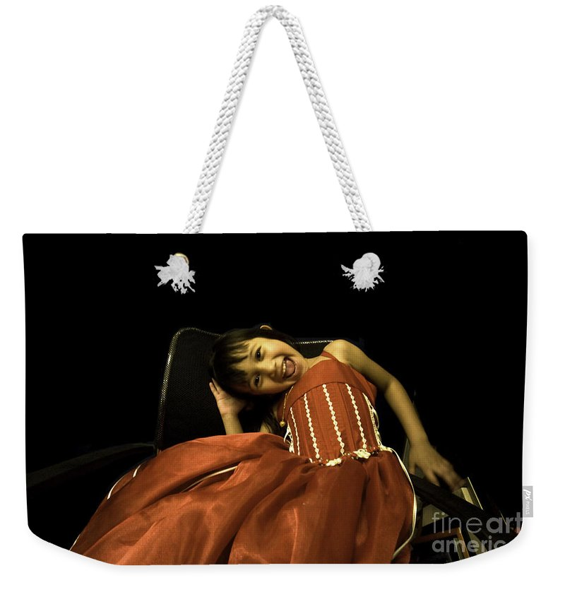 Girl Weekender Tote Bag featuring the photograph The Red Party Dress by Madeline Ellis