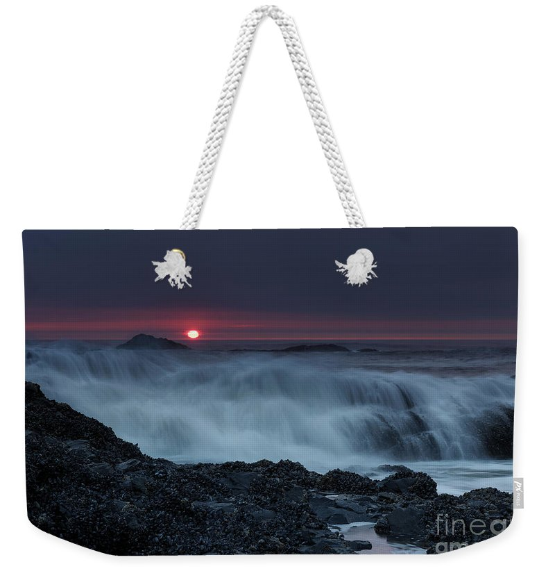 Red Weekender Tote Bag featuring the photograph The Red Sun by Masako Metz