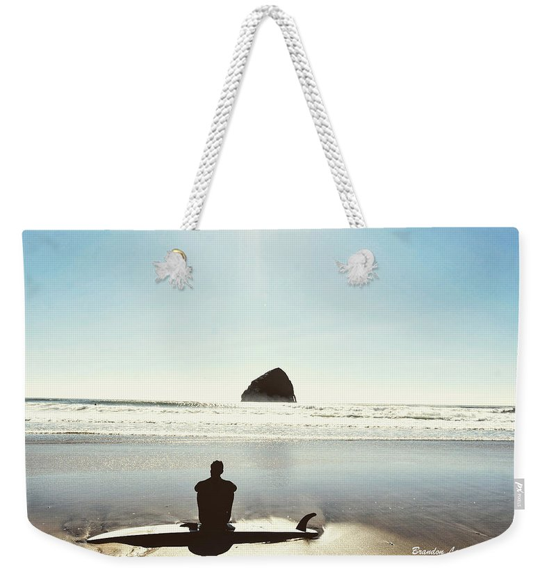 Weekender Tote Bag featuring the photograph The Resting Surfer by Brandon Larson