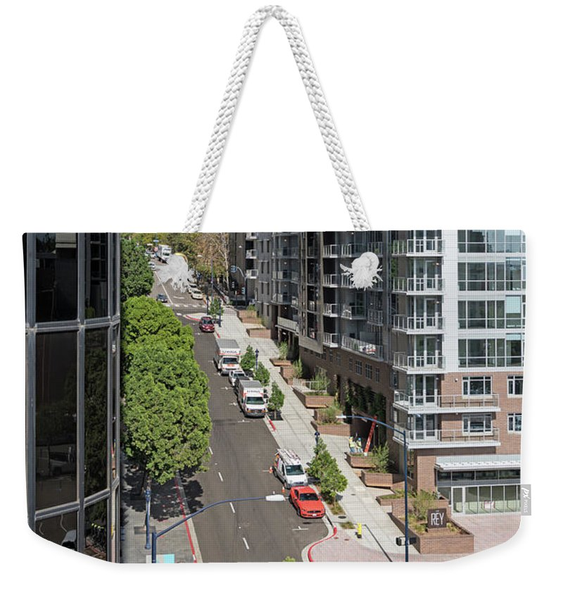 The Rey Apartment Building Weekender Tote Bag featuring the photograph The Rey Apartment Building by Robert VanDerWal