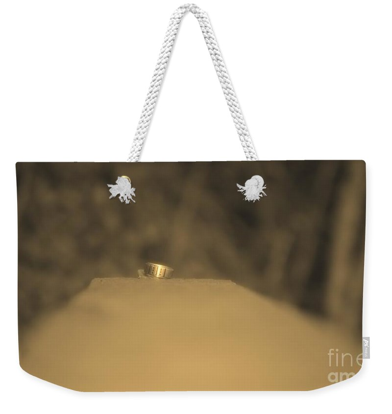 Ring Weekender Tote Bag featuring the photograph The Ring by Photos By Zulma