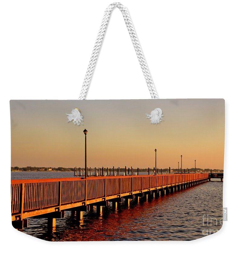 Riverwalk Weekender Tote Bag featuring the photograph The Riverwalk by Lisa Renee Ludlum