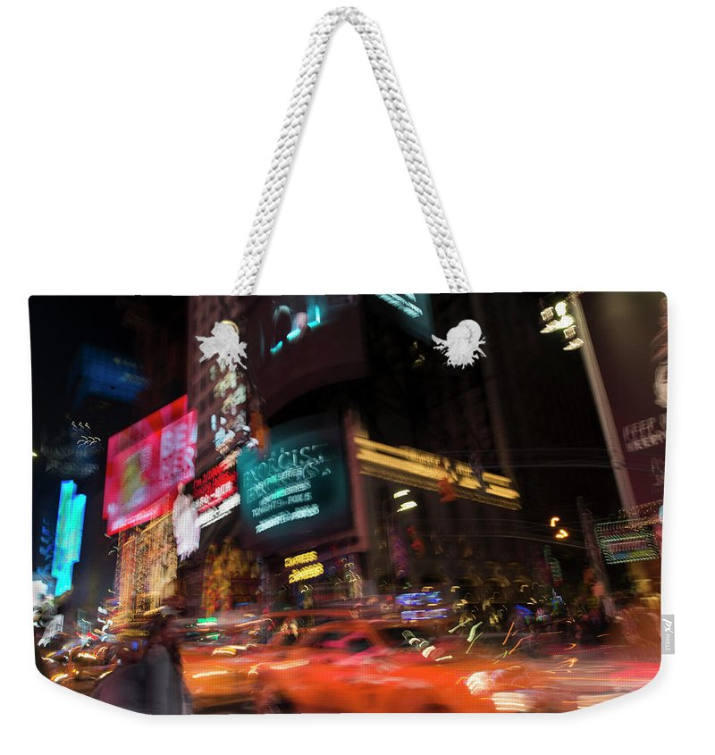 New York Weekender Tote Bag featuring the photograph The Running Of The Taxis by Alex Lapidus