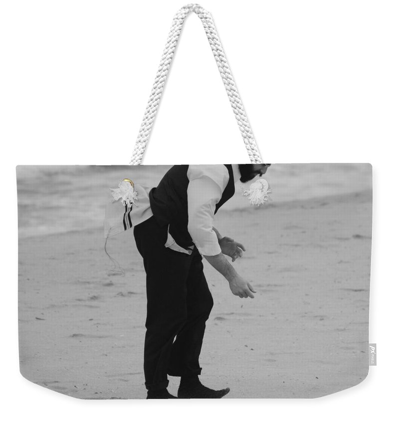 Black And White Weekender Tote Bag featuring the photograph The Search by Rob Hans