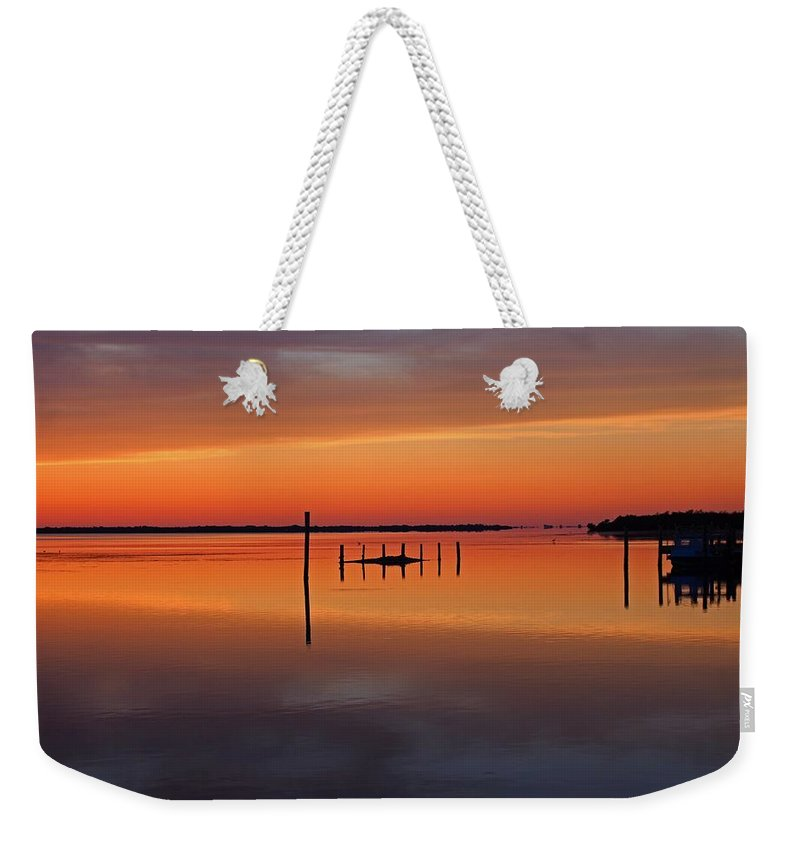 Sunset Weekender Tote Bag featuring the photograph The Seduction Wizard by Michiale Schneider