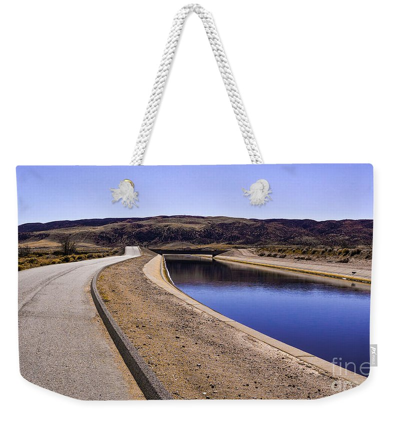 Antelope Valley Weekender Tote Bag featuring the photograph The Service Road by Joe Lach