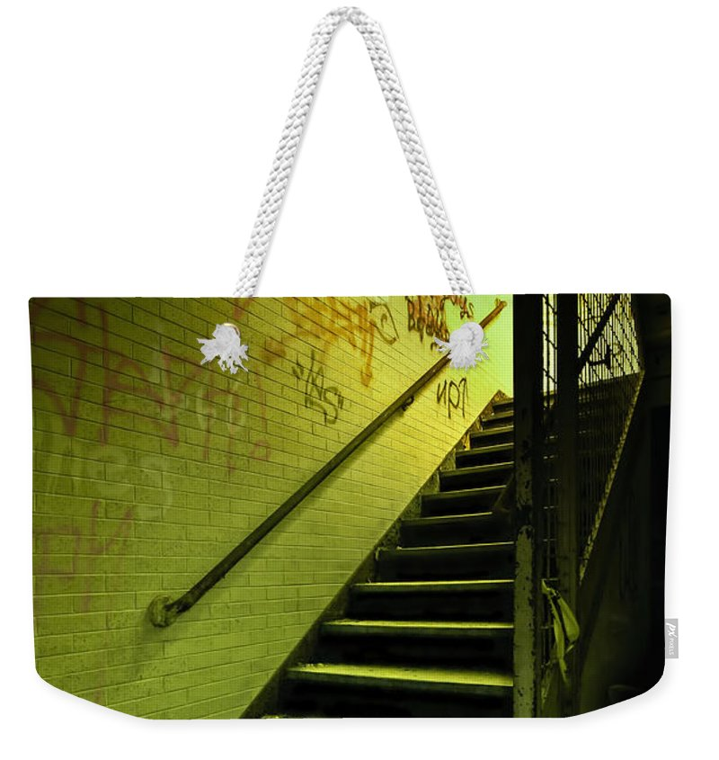 Stair Weekender Tote Bag featuring the photograph The Shining Darkness by Evelina Kremsdorf