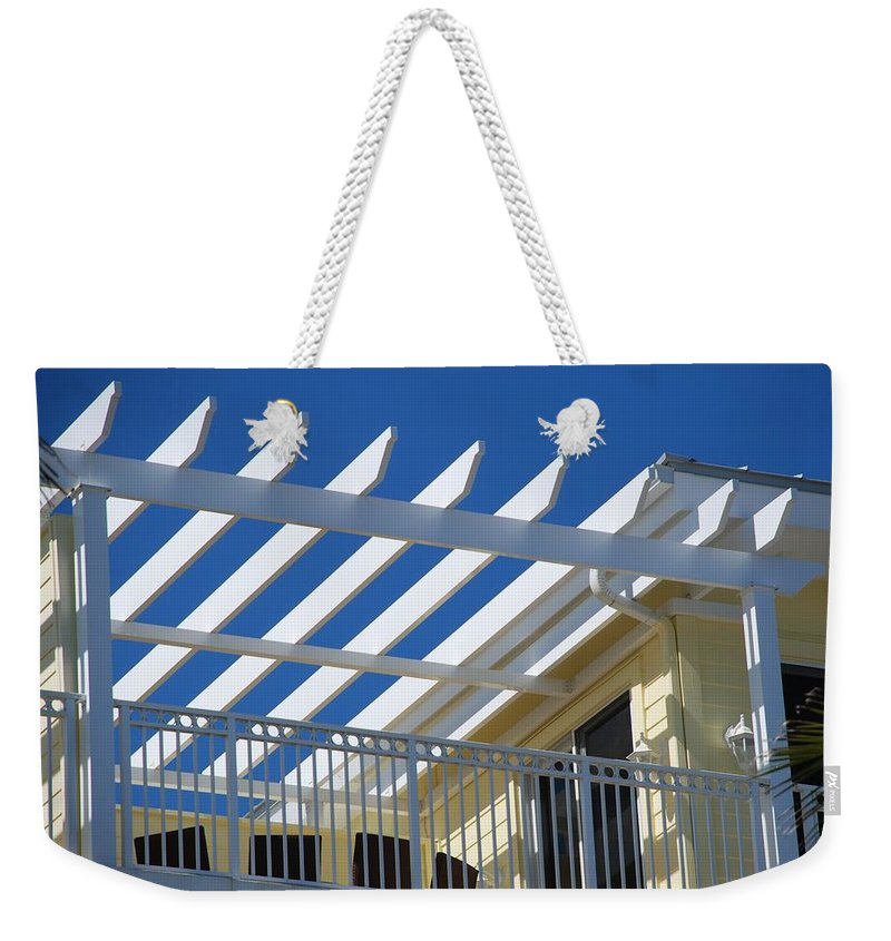 Architecture Weekender Tote Bag featuring the photograph The Slots by Rob Hans