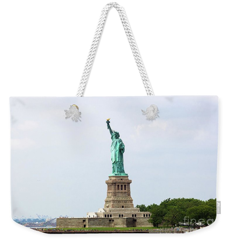 Tourism Weekender Tote Bag featuring the photograph The Statue Of Liberty In New York City by Antonio Gravante