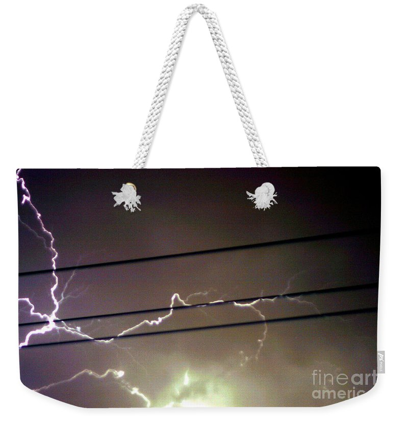 Sky Weekender Tote Bag featuring the photograph The Storm 1.4 by Joseph A Langley