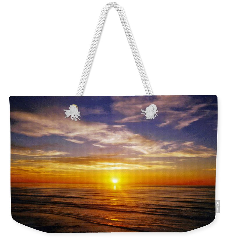 Sunset Weekender Tote Bag featuring the photograph The Sun Says Goodnight by Jean Haynes