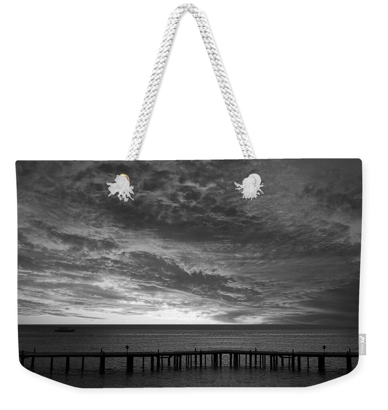 Sun Weekender Tote Bag featuring the photograph The Sunset by Munir Alawi