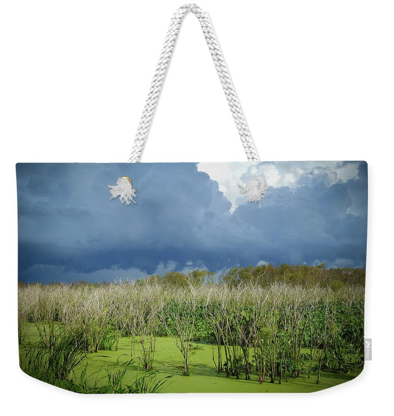 Clouds Weekender Tote Bag featuring the photograph The Thunder Rolls by Elie Wolf