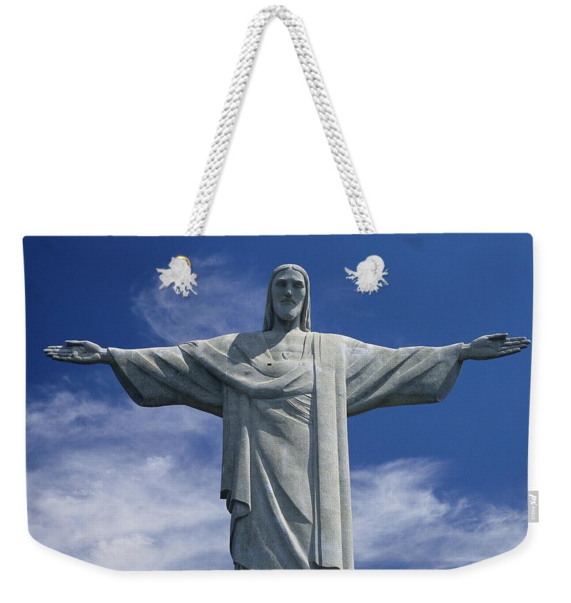 South America Weekender Tote Bag featuring the photograph The Towering Statue Of Christ by Richard Nowitz