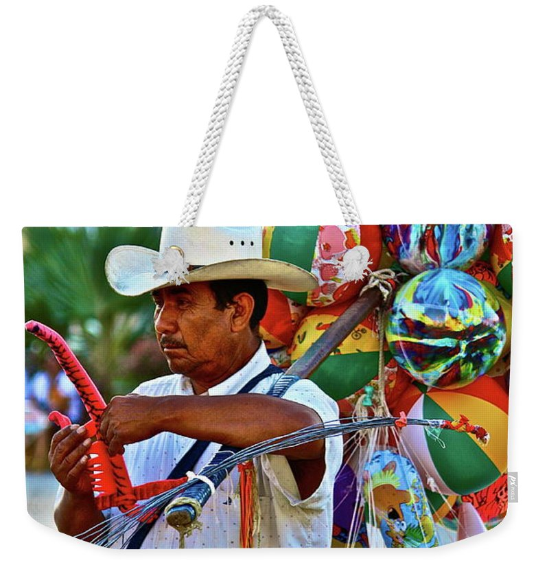 Toys Weekender Tote Bag featuring the photograph The Toy Man by Diana Hatcher