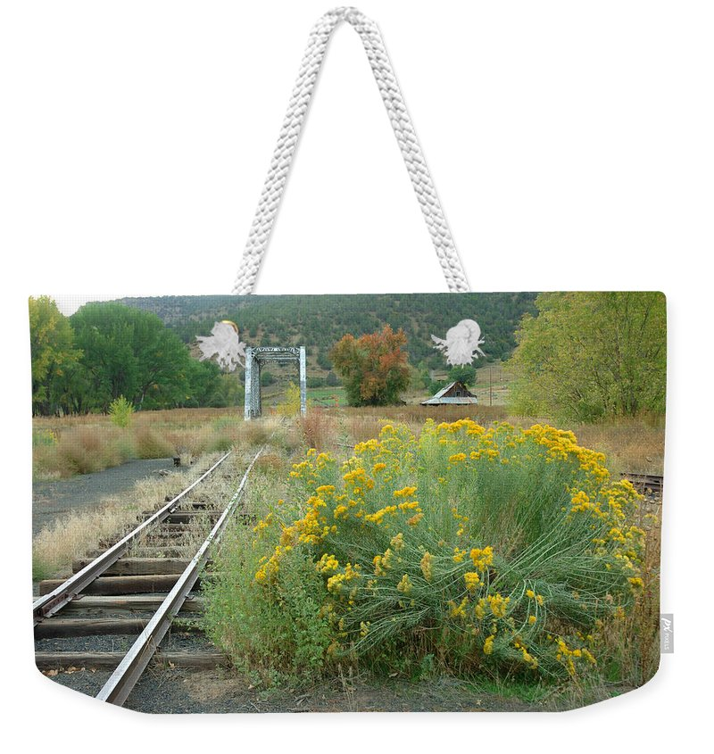 Train Weekender Tote Bag featuring the photograph The Tracks At Pagosa Junction by Jerry McElroy