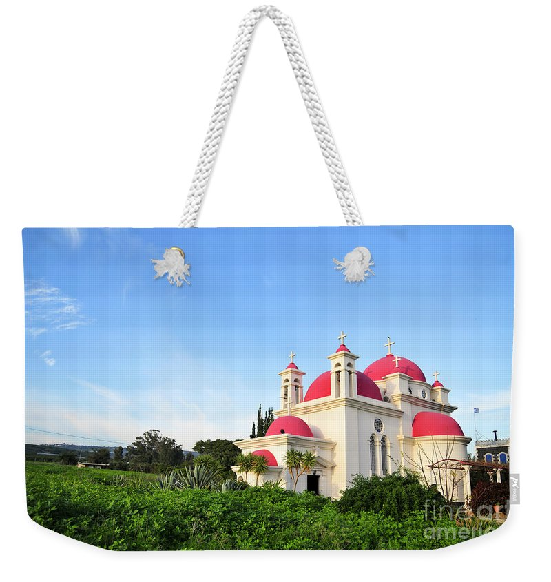 Israel Weekender Tote Bag featuring the photograph the Twelve Apostles Church by Shay Levy