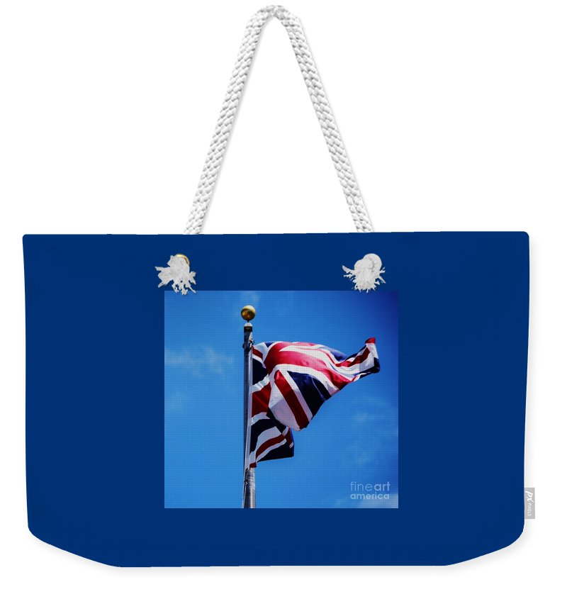 Flag Patriotism British Flag Emble Of A Nation Iconic Image Uk Flag Blue Background Union Jack Movement National Pride Historic Symbol Famous Poster Print Metal Frame Canvas Print Available On T Shirts Tote Bags Throw Pillows Phone Cases Duvet Covers Coffee Or Tea Mugs And Shower Curtains Weekender Tote Bag featuring the photograph The Flag Of Great Britain by Poet's Eye