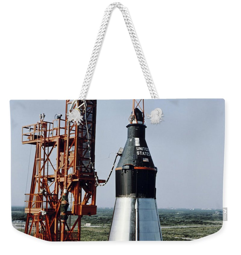 1961 Weekender Tote Bag featuring the photograph The Unmanned Mercury-atlas Capsule Sits by Stocktrek Images
