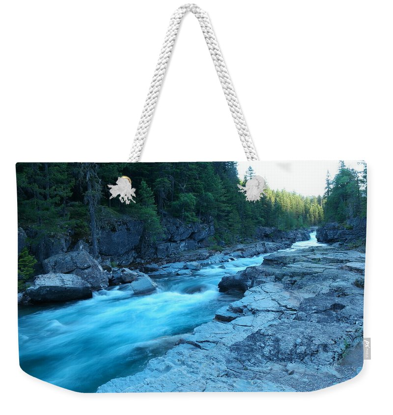 Rivers Weekender Tote Bag featuring the photograph The View Of A River by Jeff Swan