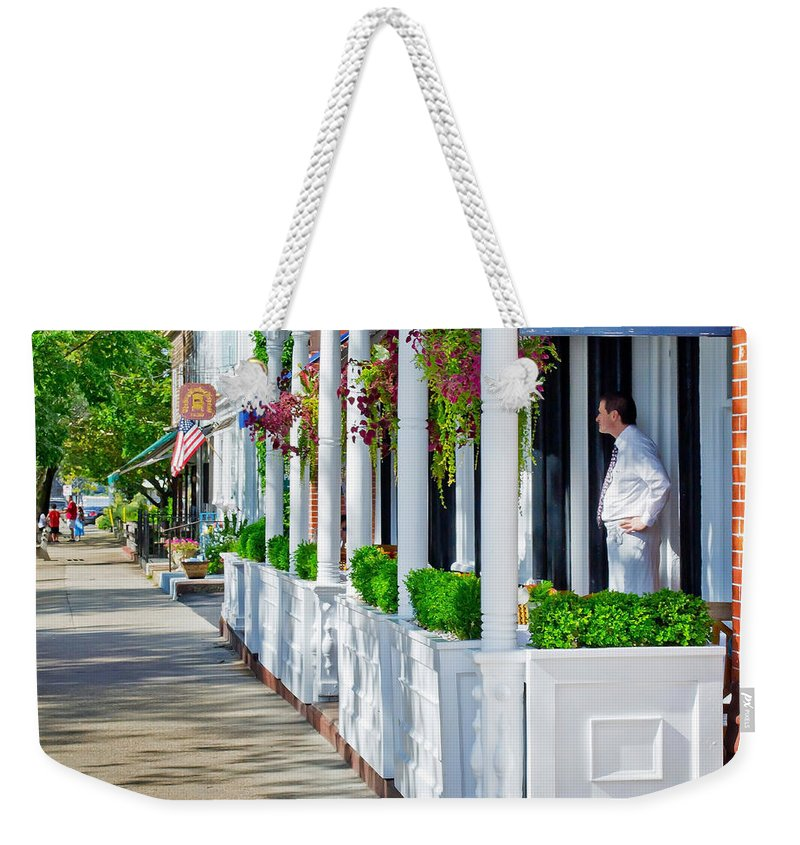 Hotel Weekender Tote Bag featuring the photograph The Waiter by Keith Armstrong