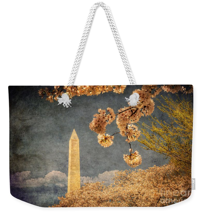 Washington Weekender Tote Bag featuring the photograph The Washington Monument by Lois Bryan