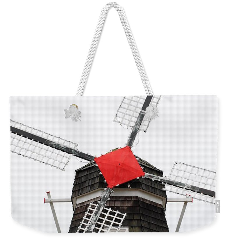 Dutch Weekender Tote Bag featuring the photograph The Windmill by Jost Houk
