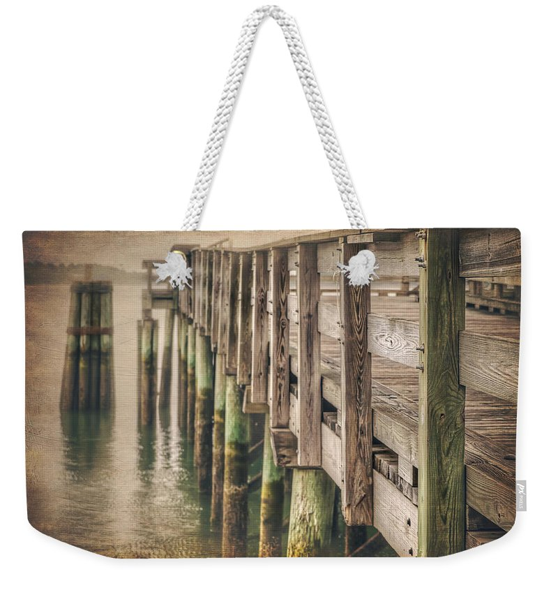 Pier Weekender Tote Bag featuring the photograph The Wooden Pier by Carol Japp