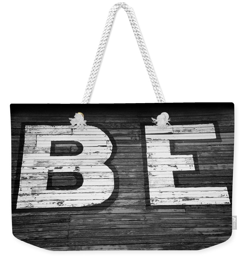 Paint Weekender Tote Bag featuring the photograph The Word Be Painted On The Side Of Old Building by John Harmon
