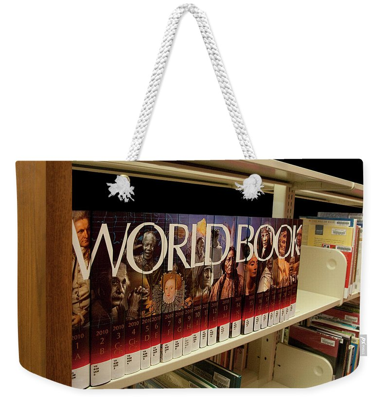 Book Weekender Tote Bag featuring the photograph The World In The Library - Encyclopedias by Mitch Spence