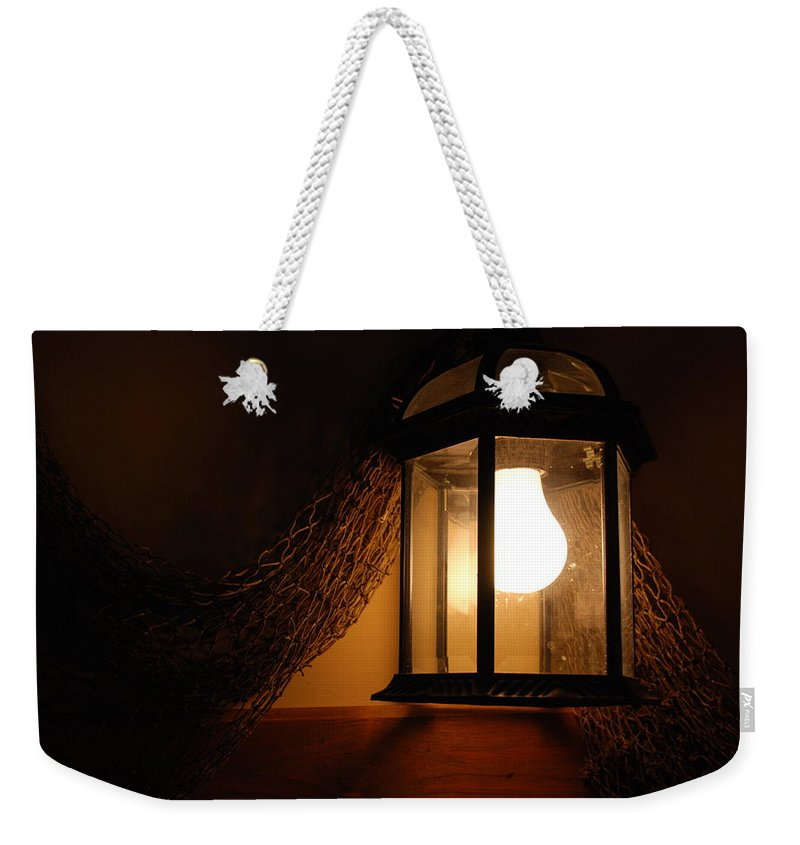 Lantern Weekender Tote Bag featuring the photograph There Is Light In The Dark by Susanne Van Hulst