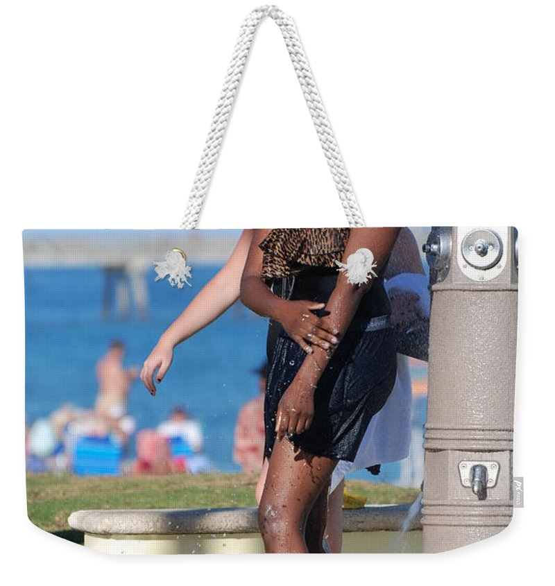 Bathing Suit Weekender Tote Bag featuring the photograph Three Arms At The Shower by Rob Hans