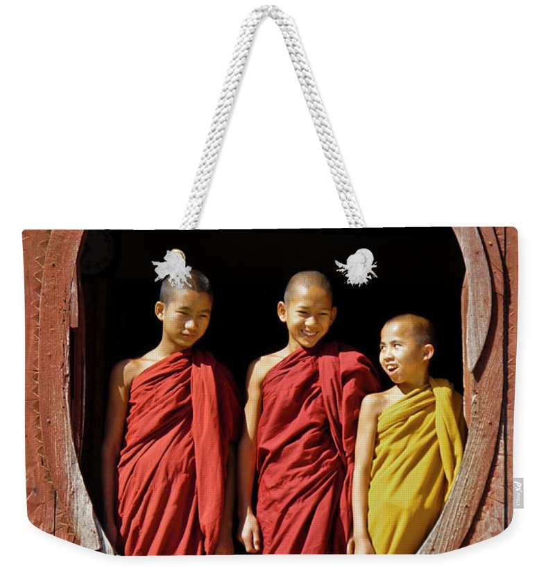 Asia Weekender Tote Bag featuring the photograph Three Monklets by Michele Burgess