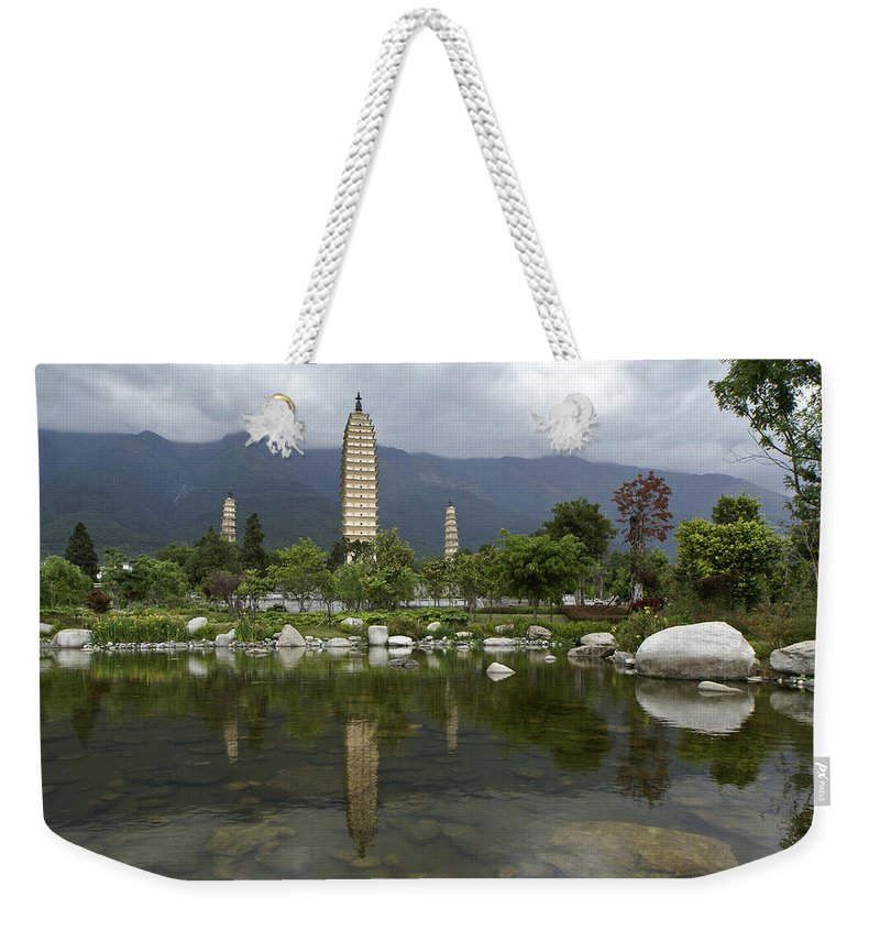 Asia Weekender Tote Bag featuring the photograph Three Pagodas Of Dali by Michele Burgess