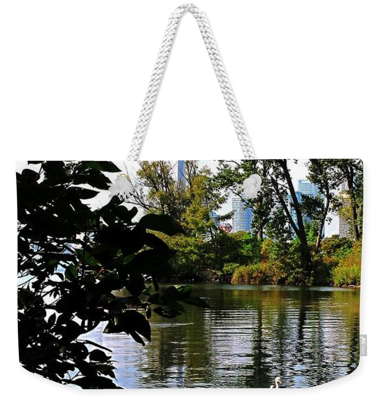 Swans Weekender Tote Bag featuring the photograph Three Swans And The Cn Tower by Ian MacDonald
