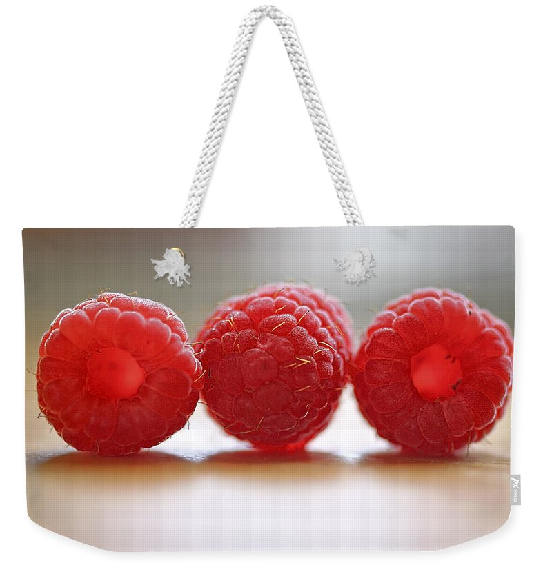 Raspberry Weekender Tote Bag featuring the photograph Three's Company by Evelina Kremsdorf