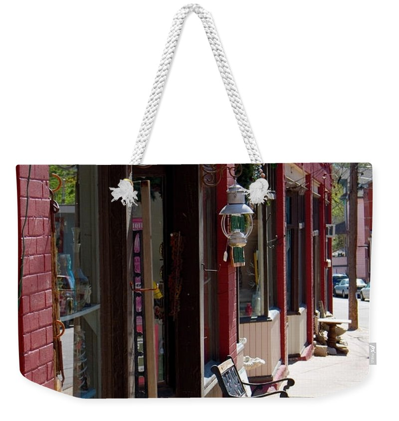 Thrift Store Weekender Tote Bag featuring the photograph Thrift Shop And Sign In Manitou Springs by Steve Krull