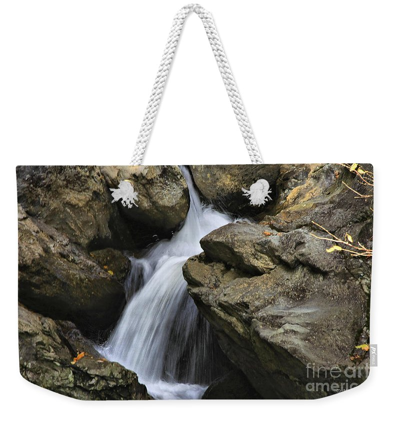 Water Weekender Tote Bag featuring the photograph Through The Rocks by Deborah Benoit