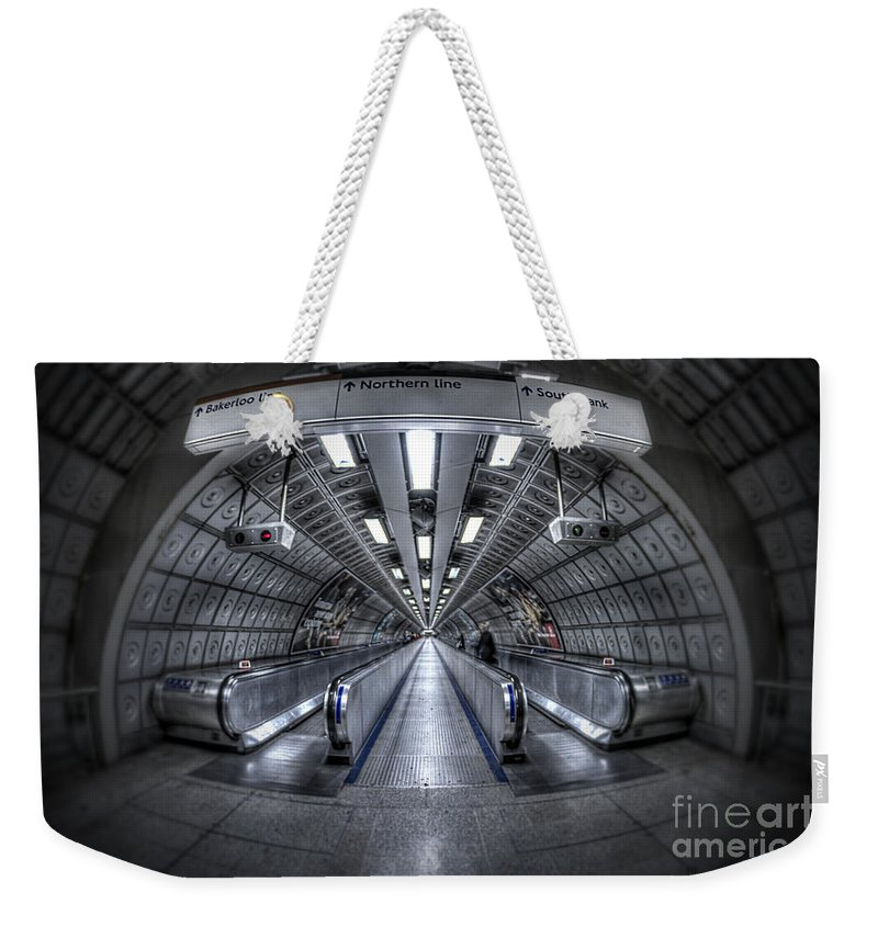 Architecture Weekender Tote Bag featuring the photograph Through The Tunnel by Evelina Kremsdorf