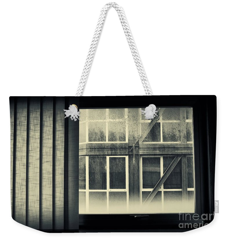 Abstract Weekender Tote Bag featuring the photograph Through The Window by Silvia Ganora